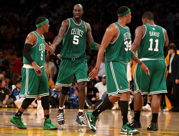 LOS ANGELES, CA - JUNE 17:  (L-R) Rajon Rondo #9, Kevin Garnett #5, Paul Pierce #34 and Glen Davis #11 of the Boston Celtics walk across the court in the second half against the Los Angeles Lakers in Game Seven of the 2010 NBA Finals at Staples Center on