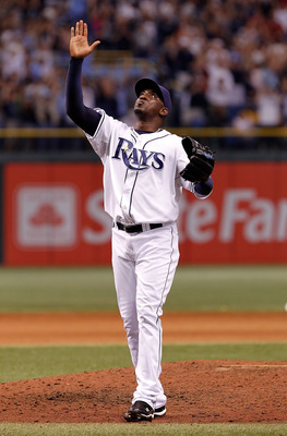 ST. PETERSBURG, FL - SEPTEMBER 15:  Relief pitcher Rafael Soriano #29 of the Tampa Bay Rays celebrates his save against the New York Yankees at Tropicana Field on September 15, 2010 in St. Petersburg, Florida.  (Photo by J. Meric/Getty Images)