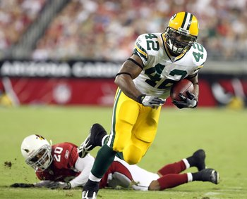 GLENDALE, AZ - AUGUST 28:  Running back DeShawn Wynn #42 of the Green Bay Packers runs with the ball past Ralph Brown #20 of the Arizona Cardinals during the game at the University of Phoenix Stadium on August 28, 2009 in Glendale, Arizona. The Packers de