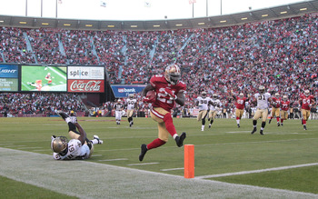 SAN FRANCISCO - SEPTEMBER 20:  Frank Gore #21 of the San Francisco 49ers scores a touchdown against the New Orleans Saints during an NFL game at Candlestick Park on September 20, 2010 in San Francisco, California.  (Photo by Jed Jacobsohn/Getty Images)