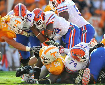 KNOXVILLE, TN - SEPTEMBER 18:  Mike Gillislee #23 of the Florida Gators drives over the goal line for a touchdown against  the Tennessee Volunteers during the first half at Neyland Stadium on September 18, 2010 in Knoxville, Tennessee.  (Photo by Grant Ha