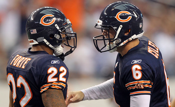 ARLINGTON, TX - SEPTEMBER 19:  (L-R) Running back Matt Forte #22 and Jay Cutler #6 of the Chicago Bears celebrate a touchdown against the Dallas Cowboys in the fourth quarter at Cowboys Stadium on September 19, 2010 in Arlington, Texas.  (Photo by Ronald