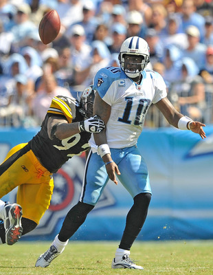 NASHVILLE, TN - SEPTEMBER 19:  James Harrison #92 of the Pittsburgh Steelers forces a fumble by quarterback Vince Young #10 of the Tennessee Titans at LP Field on September 19, 2010 in Nashville, Tennessee. The Steelers won 19-11.  (Photo by Grant Halvers
