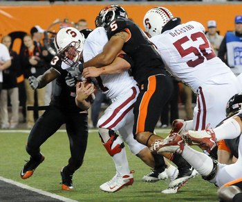 CORVALLIS, OR - OCTOBER 10: Running back Toby Gerhart #7 of the Stanford Cardinals drags safety Cameron Collins #5 of the Oregon State Beavers into the end zone as he scores a touchdown in the fourth quarter of the game at Reser Stadium on October 10, 200