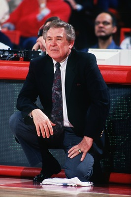 1992:  NEW JERSEY HEAD COACH BILL FITCH KNEELS ON THE SIDELINE DURING THE NETS GAME VERSUS THE DENVER NUGGETS. Mandatory Credit: Tim Defrisco/ALLSPORT