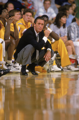 LOS ANGELES - 1988:  Head coach Pat Riley of the Los Angeles Lakers crouches on the sideline during an NBA game at the Great Western Forum in Los Angeles, California in 1988.  (Photo by: Tim Defrisco/Getty Images)