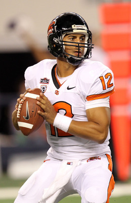 ARLINGTON, TX - SEPTEMBER 04:  Quarterback Ryan Katz #12 of the Oregon State Beavers drops back to pass against the TCU Horned Frogs at Cowboys Stadium on September 4, 2010 in Arlington, Texas.  (Photo by Ronald Martinez/Getty Images)
