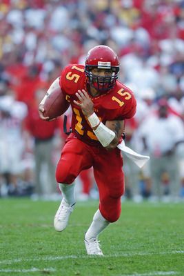 AMES, IOWA - SEPTEMBER 28:  Quarterback Seneca Wallace #15 of Iowa State races towards the endzone and scores against Nebraska on September 28, 2002 at Jack Trice Stadium in Ames, Iowa.  Iowa State defeated Nebraska 36-14.  (Photo by Matthew Stockman/Gett