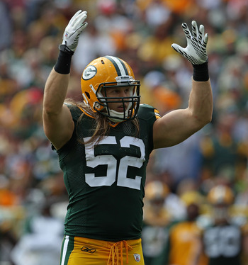 GREEN BAY, WI - SEPTEMBER 19: Clay Matthews #52 of the Green Bay Packers encourages the crowd to cheer during a game against the Buffalo Bills at Lambeau Field on September 19, 2010 in Green Bay, Wisconsin. The Packers defeated the Bills 34-7.  (Photo by