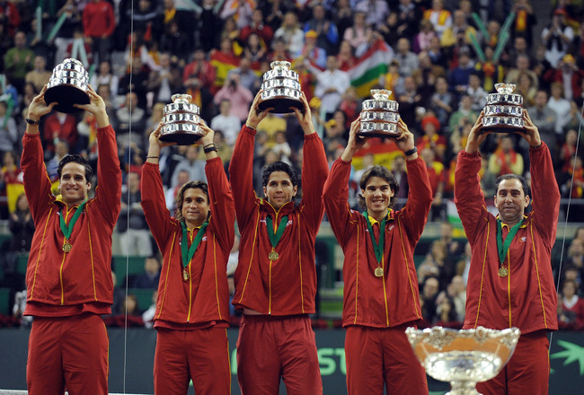 BARCELONA, SPAIN - DECEMBER 06:  Spanish players Feliciano Lopez (L), David Ferrer,  Fernando Verdasco (C) Rafael Nadal (2R) and team captain Albert Costa celebrate with the Davis Cup trophy at the end of the final match between Spain and Czech Republic a