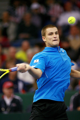 PORTLAND, OR - NOVEMBER 30:  Mikhail Youzhny of Russia forehands the ball against James Blake of the U.S. during the Davis Cup Final at the Memorial Coliseum November 30, 2007 in Portland, Oregon. (Photo by Craig Mitchelldyer/Getty Images)