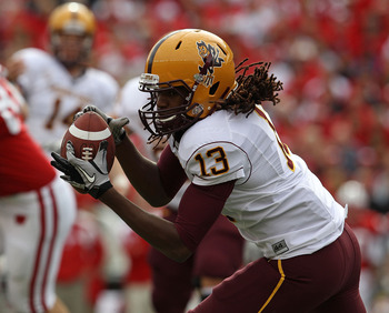 MADISON, WI - SEPTEMBER 18: Geroge Bell #13 of the Arizona State Sun Devils catches a pass for a first down against the Wisconsin Badgers at Camp Randall Stadium on September 18, 2010 in Madison, Wisconsin. (Photo by Jonathan Daniel/Getty Images)