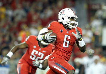 TUCSON, AZ - SEPTEMBER 18:  Wide receiver Travis Cobb #6 of the Arizona Wildcats returns a kick off for a 100 yard touchdown against the Iowa Hawkeyes during the second quarter of the college football game at Arizona Stadium on September 18, 2010 in Tucso