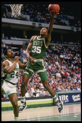 Guard Reggie Lewis of the Boston Celtics lays up the ball during a game against the Milwaukee Bucks at the Bradley Center in Milwaukee, Wisconsin.