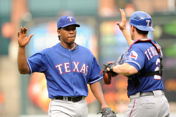 BALTIMORE - AUGUST 22:  Neftali Feliz #30 of the Texas Rangers celebrates with Taylor Teagarden #2 after a 6-4 victory against the Baltimore Orioles at Camden Yards on August 22, 2010 in Baltimore, Maryland.  (Photo by Greg Fiume/Getty Images)