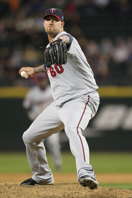 SEATTLE - AUGUST 27:  Relief pitcher Jon Rauch #60 of the Minnesota Twins pitches against the Seattle Mariners at Safeco Field on August 27, 2010 in Seattle, Washington. The Twins won 6-3. (Photo by Otto Greule Jr/Getty Images)