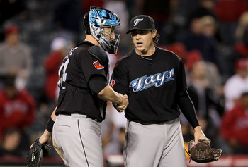 ANAHEIM, CA - MAY 24:  Catcher John Buck #14 and relief pitcher Scott Downs #37 of the Toronto Blue Jays congratulate each other following their victory over the Los Angeles Angels of Anaheim at Anaheim Stadium on May 24, 2010 in Anaheim, California. The