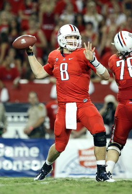 TUCSON, AZ - SEPTEMBER 18:  Quarterback Nick Foles #8 of the Arizona Wildcats throws a pass during the college football game against the Iowa Hawkeyes at Arizona Stadium on September 18, 2010 in Tucson, Arizona. The Wildcats defeated the Hawkeyes 34-27.