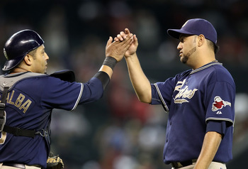 PHOENIX - AUGUST 08:  Relief pitcher Edward Mujica #45 of the San Diego Padres high fives catcher Yorvit Torrealba #8 after defeating the Arizona Diamondbacks in the Major League Baseball game at Chase Field on August 8, 2010 in Phoenix, Arizona.  The Pad