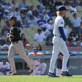 LOS ANGELES, CA - SEPTEMBER 18:  Relief pitcher Jeff Weaver (R) #36 of the Los Angeles Dodgers looks on as Carlos Gonzalez #5 of the Colorado Rockies scores a run on Melvin Mora's grand slam in the eighth inning at Dodger Stadium on September 18, 2010 in
