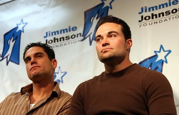 DAYTONA BEACH, FL - FEBRUARY 11:  Marcus Giles and Mike Hampton of the Atlanta Braves listen as Jimmie Johnson announces the creation of the 'Jimmie Johnson Foundation' February 11, 2006 at Daytona International Speedway in Daytona Beach, Florida.  (Photo