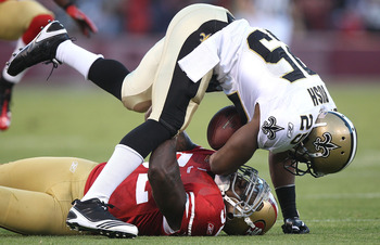 SAN FRANCISCO - SEPTEMBER 20:  Patrick Willis #52 of the San Francisco 49er tackles Reggie Bush #25 of the New Orleans Saints during an NFL game at Candlestick Park on September 20, 2010 in San Francisco, California.  (Photo by Jed Jacobsohn/Getty Images)