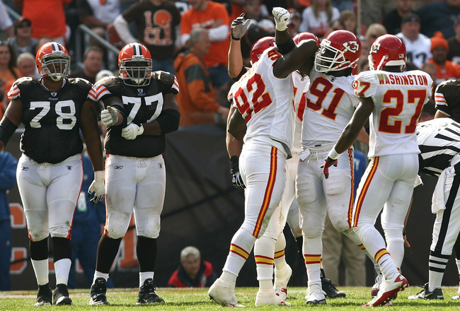 CLEVELAND - SEPTEMBER 19:  Defenders Wallace Gilberry #92, Tamba Hali #91 and Donald Washington #27 of the Kansas City Chiefs celebrate a sack against the Cleveland Browns at Cleveland Browns Stadium on September 19, 2010 in Cleveland, Ohio.  (Photo by Ma