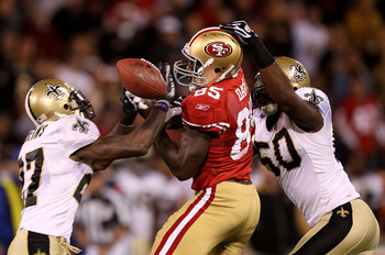 SAN FRANCISCO - SEPTEMBER 20:  Vernon Davis #85 of the San Francisco 49er fails to catch a pass as he is defended by Malcolm Jenkins #27 and Marvin Mitchell #50 of the New Orleans Saints during an NFL game at Candlestick Park on September 20, 2010 in San