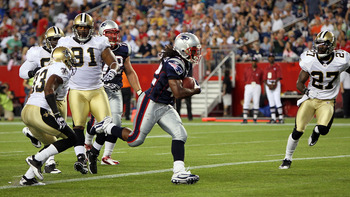 FOXBORO, MA - AUGUST 12: BenJarvus Green-Ellis #42 of the New England Patriots scores a touchdown during the first quarter of a preseason game against the New Orleans Saints at Gillette Stadium on August 12, 2010 in Foxboro, Massachusetts. (Photo by Jim R