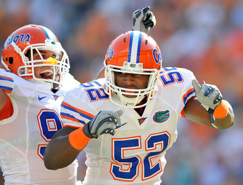 KNOXVILLE, TN - SEPTEMBER 18:  Jonathan Bostic #52 of the Florida Gators celebrates with teammate Justin Trattou #94 after intercepting a pass by quarterback Matt Simms #2 of the Tennessee Volunteers in the end zone during the first half at Neyland Stadiu