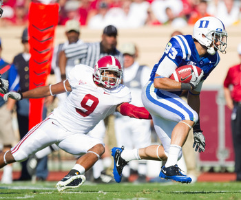DURHAM, NC - SEPTEMBER 18: Austin Kelly #83 of the Duke Blue Devils runs away from Phelon Jones #9 of the Alabama Crimson Tide at Wallace Wade Stadium on September 18, 2010 in Durham, North Carolina.  The Crimson Tide defeated the Blue Devils 62-13.  (Pho
