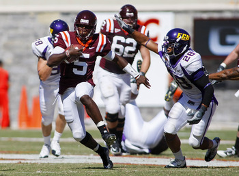 BLACKSBURG, VA - SEPTEMBER 18:  Quarterback Tyrod Taylor #5 of the Virginia Tech hokies runs with the ball as  linebacker Matt Thompson #28 of the East Carolina Pirates defends at Lane Stadium on September 18, 2010 in Blacksburg, Virginia.  (Photo by Geof