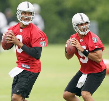 NAPA, CA - AUGUST 01:  Jason Campbell #8 and Bruce Gradkowski #5 of the Oakland Raiders work out during the Raiders training camp at their Napa Valley Training Complex on August 1, 2010 in Napa, California.  (Photo by Ezra Shaw/Getty Images)