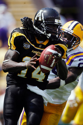 BATON ROUGE, LA - AUGUST 30:  Quarterback Armanti Edwards #14 of the Appalachian State Mountaineers avoids a sack by Harry Coleman #24 of the Louisiana State University Tigers on August 30, 2008 at Tiger Stadium in Baton Rouge, Louisiana.  (Photo by Chris