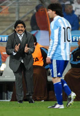 JOHANNESBURG, SOUTH AFRICA - JUNE 27:  Diego Maradona head coach of Argentina gestures as Lionel Messi walks past during the 2010 FIFA World Cup South Africa Round of Sixteen match between Argentina and Mexico at Soccer City Stadium on June 27, 2010 in Jo