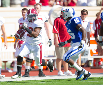 DURHAM, NC - SEPTEMBER 18: Mark Ingram #22 of the Alabama Crimson Tide runs down the sideline away from Chris Rwabukamba #16 of the Duke Blue Devils at Wallace Wade Stadium on September 18, 2010 in Durham, North Carolina.  The Crimson Tide defeated the Bl