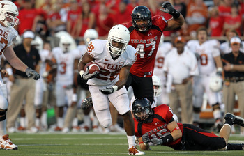 LUBBOCK, TX - SEPTEMBER 18:  Running back Foswhitt Whittaker #28 of the Texas Longhorns runs the ball past Cody Davis #16 of the Texas Tech Red Raiders at Jones AT&amp;T Stadium on September 18, 2010 in Lubbock, Texas.  (Photo by Ronald Martinez/Getty Images)