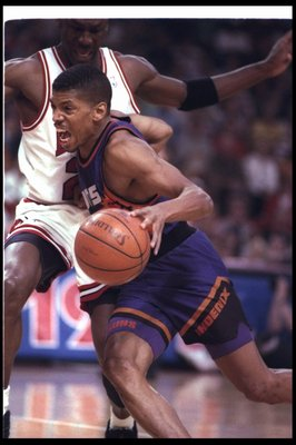 18 Jun 1993: Guard Kevin Johnson of the Phoenix Suns moves the ball during a game against the Chicago Bulls at the United Center in Chicago, Illinois. The Suns won the game, 108-98.