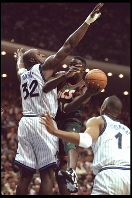 5 Jan 1996:  Forward Shawn Kemp of the Seattle Supersonics goes up for a shot against Orlando Magic center Shaquille O'Neal and guard Penny Hardaway during a game played at the Orlando Arena in Orlando, Florida.  The Magic won the game, 115-93. Mandatory