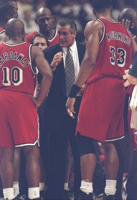 20 May 1997: Center Alonzo Mourning and guard Tim Hardaway listen to coach Pat Riley of the Miami Heat during a game against the Chicago Bulls at the United Center in Chicago, Illinois. The Bulls won the game 84-77.