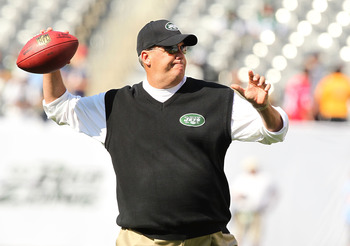 EAST RUTHERFORD, NJ - SEPTEMBER 19:  Head coach Rex Ryan of the New York Jets throws passes before the game against the New England Patriots on September 19, 2010 at the New Meadowlands Stadium in East Rutherford, New Jersey.  (Photo by Al Bello/Getty Ima