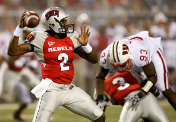 LAS VEGAS - SEPTEMBER 04:  Quarterback Omar Clayton #2 of the UNLV Rebels looks to pass against the Wisconsin Badgers during the third quarter of their game at Sam Boyd Stadium September 4, 2010 in Las Vegas, Nevada. Wisconsin won 41-21.  (Photo by Ethan