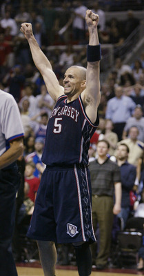 AUBURN HILLS - MAY 14: Jason Kidd #5 of the New Jersey Nets raises his arms in celebration as a foul was called against the Detroit Pistons in Game five of the NBA Eastern Conference Semi-Finals on May 14, 2004 at The Palace of Auburn Hills, Michigan. The