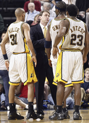 INDIANAPOLIS - APRIL 17:  Head coach Rick Carlisle of the Indiana Pacers talks with Reggie Miller #31, Jermaine O'Neal #7 and Ron Artest #23 during the game against the Boston Celtics on April 17, 2004 at the Conseco Fieldhouse in Indianapolis, Indiana. T