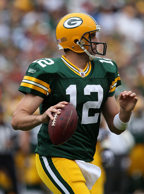 GREEN BAY, WI - SEPTEMBER 19: Aaron Rodgers #12 of the Green Bay Packers rolls out to look for a receiver against the Buffalo Bills at Lambeau Field on September 19, 2010 in Green Bay, Wisconsin. The Packers defeated the Bills 34-7. (Photo by Jonathan Dan