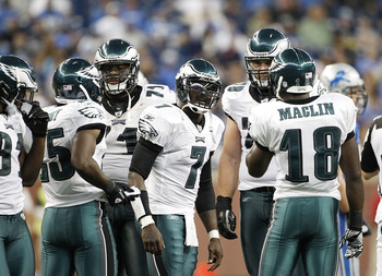 DETROIT - SEPTEMBER 19:  Michael Vick #7 of the Philadelphia Eagles calls the play in the huddle during the third quarter of the game against the Detroit Lions at Ford Field on September 19, 2010 in Detroit, Michigan. The Eagles defeated the Lions 35-32.