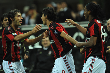 MILAN, ITALY - SEPTEMBER 18:  Filippo Inzaghi (C) of AC Milan celebrates his goal with Andrea Pirlo (L) and Ronaldinho (R) during the Serie A match between AC Milan and Catania Calcio at Stadio Giuseppe Meazza on September 18, 2010 in Milan, Italy.  (Phot