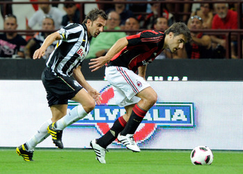 MILAN, ITALY - AUGUST 22:  Sokratis Papasthatopoulos of AC Milan and Alessandro Del Piero of Juventus FC in action during the Berlusconi Trophy match between Milan and Juventus at Giuseppe Meazza Stadium on August 22, 2010 in Milan, Italy.  (Photo by Clau