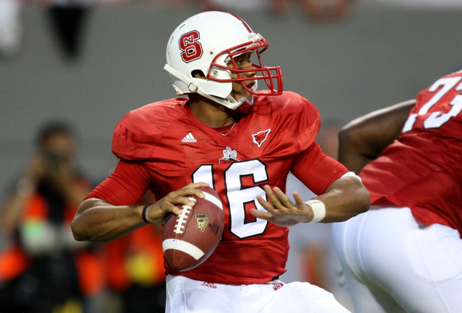 RALEIGH, NC - SEPTEMBER 3:  Quarterback Russell Wilson #16 of the North Carolina State Wolfpack drops back to pass against the South Carolina Gamecocks during the game at Carter-Finley Stadium on September 3, 2009 in Raleigh, North Carolina. (Photo by Str