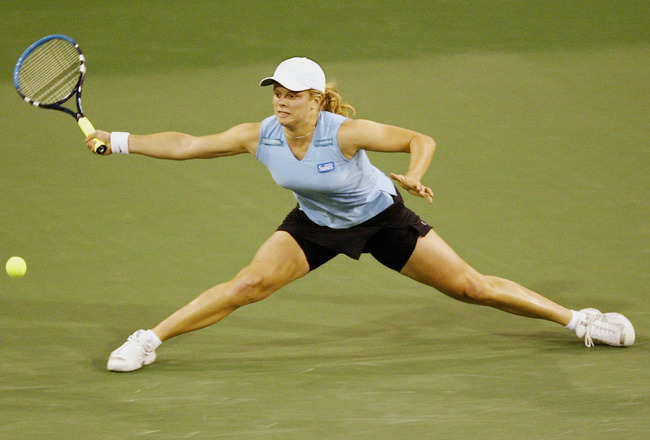 08 Mar 2002:  Kim Clijsters of Belgium does the splits but can''t make a good return against Nathalie Dechy of France during the Pacific Life Open at the Indian Wells Tennis Garden in Indian Wells, California.  Dechy upset Clijsters in straight sets.  DIG